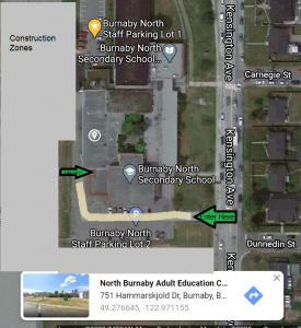 Access the NBAEC from the South driveway between the construction zone and the school building on Kensington